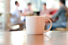 stock-photo-55566008-coffee-cup-on-the-table-in-coffee-shop